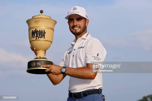 Abraham Ancer of Mexico poses with the trophy after winning the FedEx St. Jude Invitational after the second playoff hole at TPC Southwind on August...