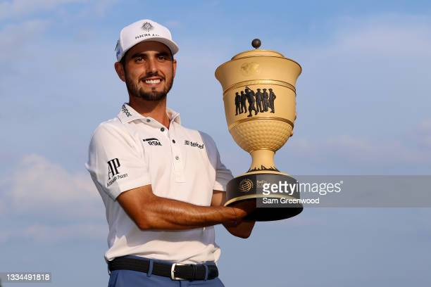 Abraham Ancer of Mexico poses with the trophy after winning the World Golf Championship- FedEx St. Jude Invitational at TPC Southwind on August 08,...