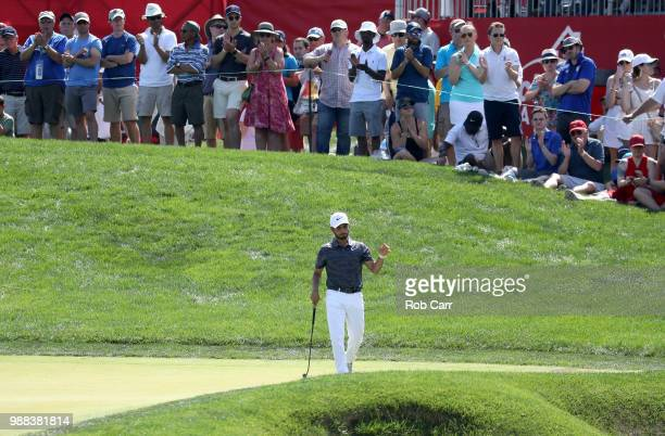 Abraham Ancer of Mexico reacts after a birdie putt on the 16th green during the third round of the Quicken Loans National at TPC Potomac on June 30...