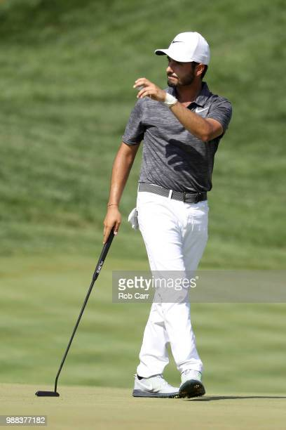 Abraham Ancer of Mexico reacts after a putt on the 18th green during the third round of the Quicken Loans National at TPC Potomac on June 30, 2018 in...
