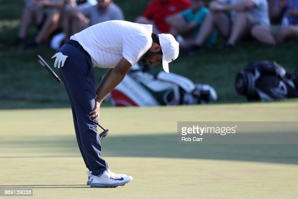 Abraham Ancer of Mexico reacts after a putt on the 18th green during the final round of the Quicken Loans National at TPC Potomac on July 1 2018 in...