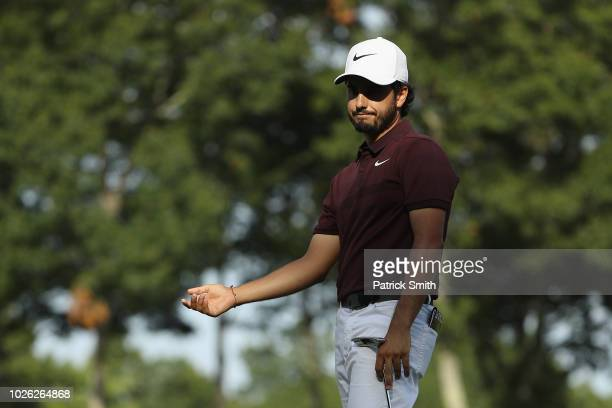 Abraham Ancer of Mexico reacts on the 14th green during round three of the Dell Technologies Championship at TPC Boston on September 2 2018 in Norton...
