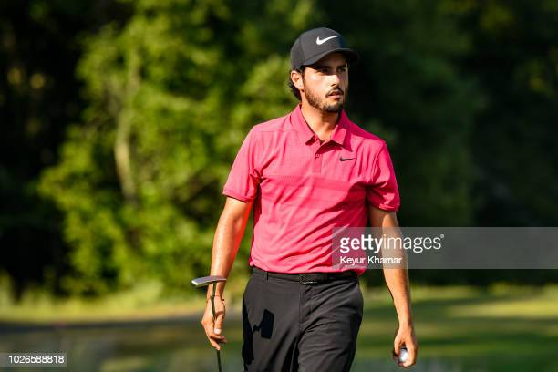 Abraham Ancer of Mexico reacts to his putt on the 12th hole green during the final round of the Dell Technologies Championship at TPC Boston on...