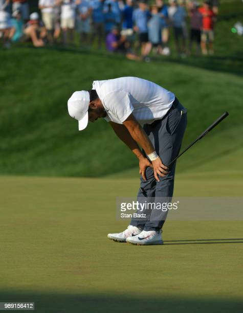 Abraham Ancer of Mexico reacts to his putt on the 18th hole during the final round of the Quicken Loans National at TPC Potomac at Avenel Farm on...