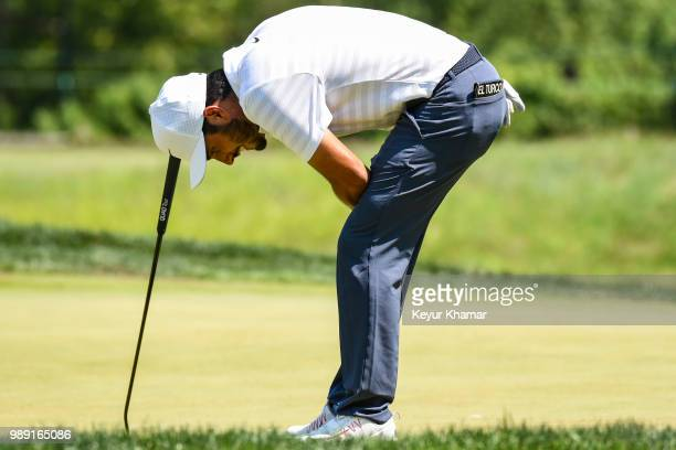 Abraham Ancer of Mexico reacts to his putt on the fifth hole green during the final round of the Quicken Loans National at TPC Potomac at Avenel Farm...