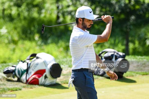 Abraham Ancer of Mexico reacts to his putt on the sixth hole green during the final round of the Quicken Loans National at TPC Potomac at Avenel Farm...