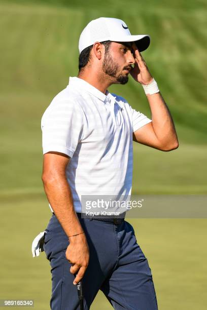 Abraham Ancer of Mexico reacts to missing a par putt on the 15th hole green during the final round of the Quicken Loans National at TPC Potomac at...