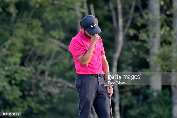 Abraham Ancer of Mexico reacts to missing his putt at the 18th hole making bogey during the final round of the Dell Technologies Championship at TPC...