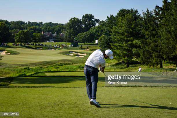 Abraham Ancer of Mexico tees off on the 14th hole during the final round of the Quicken Loans National at TPC Potomac at Avenel Farm on July 01 2018...
