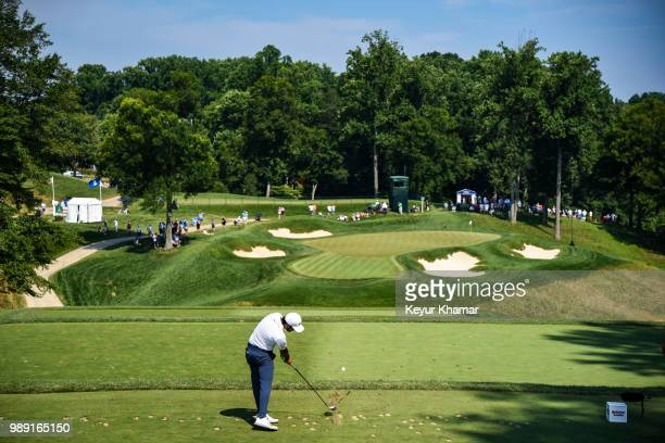 Abraham Ancer of Mexico tees off on the ninth hole during the final round of the Quicken Loans National at TPC Potomac at Avenel Farm on July 01 2018...