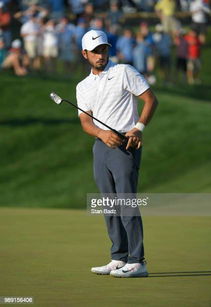 Abraham Ancer of Mexico watches his putt on the 18th hole during the final round of the Quicken Loans National at TPC Potomac at Avenel Farm on July...