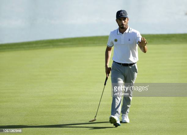 Abraham Ancer of Mexico waves after making par on the 18th hole during the second round of the Desert Classic at Jack Nicklaus Tournament Course on...