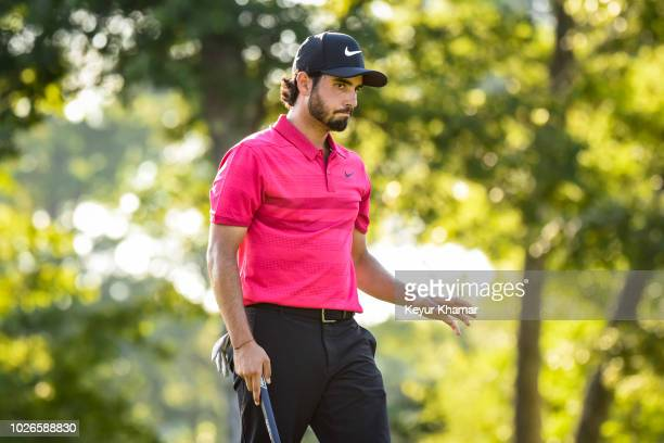 Abraham Ancer of Mexico waves to fans after making a birdie putt on the 15th hole green during the final round of the Dell Technologies Championship...