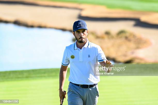 Abraham Ancer of Mexico waves to fans after making a par putt on the 18th hole green during the second round of the Desert Classic on the Nicklaus...