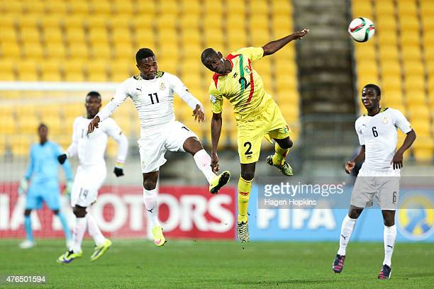 Abraham Attobrah of Ghana and Mohamed Diallo of Mali compete for a header during the FIFA U20 World Cup New Zealand 2015 Round of 16 match between...