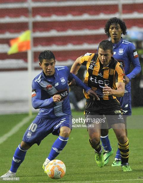 Abraham Cabrera of Bolivia's Strongest and Fernando Gaibor of Ecuador's Emelec vie for the ball during their Libertadores Cup football match in La...