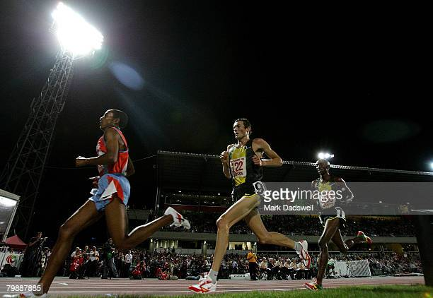 Abraham Cherkos Feleke of Ethiopia leads Craig Mottram of Australia and Shadrack Kosgei of Kenya during the Mens 5000 Metres during the Melbourne...