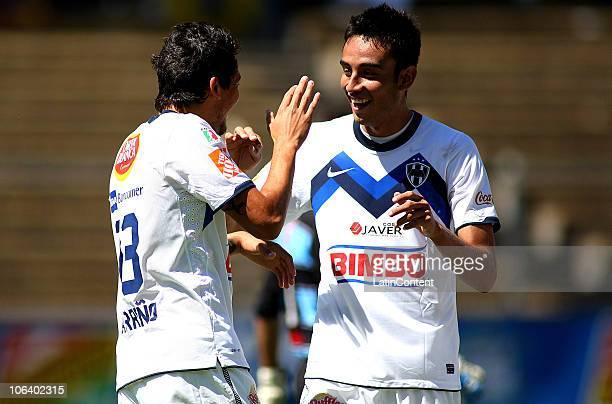 Abraham Dario Carreno of Monterrey celebrates his scored goal over Monarcas Morelia with teammate Eduardo Zavala during their match as part of the...