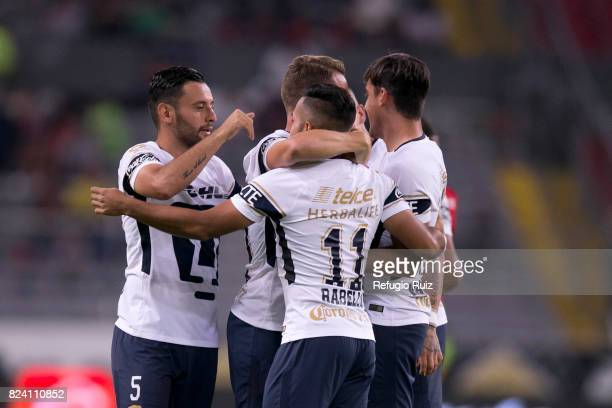 Abraham Gonzalez of Pumas celebrates with teammates after scoring the firts goal of his team during the 2nd round match between Atlas and Pumas UNAM...