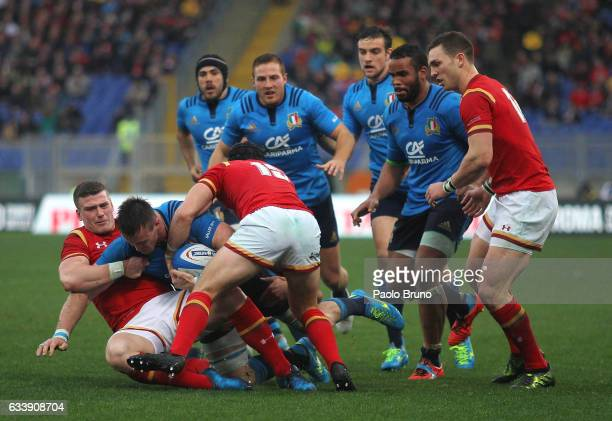 Abraham Jurgens Steyn of Italy is tackled by Scott Williams of Wales during the RBS Six Nations match between Italy and Wales at Stadio Olimpico on...