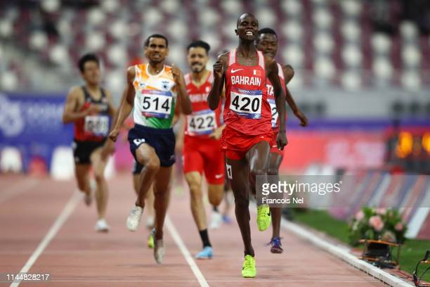 Abraham Kipchirchir Rotich of Bahrain celebrates as he crosses the line to win the Men's 1500m Final race during Day Four of the 23rd Asian Athletics...