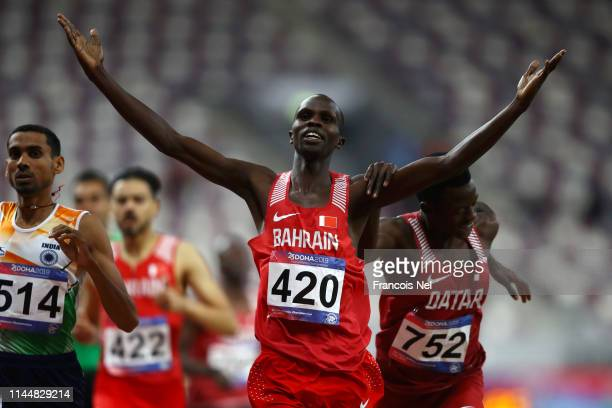 Abraham Kipchirchir Rotich of Bahrain celebrates crossing the line to win the Men's 1500m Final race followed by Ajay Kumar Saroj of India and Musaab...