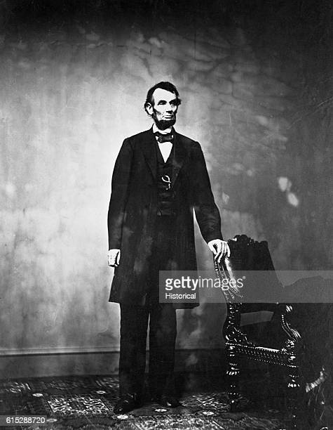 Abraham Lincoln 16th president of the United States stands next to a chair Lincoln declared the Emancipation Proclamation in 1863 freeing all slaves...