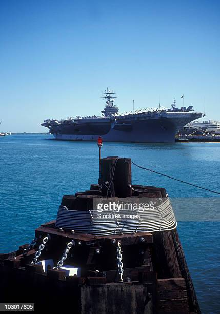 uss abraham lincoln docked pierside at pearl harbor naval station. - pearl harbor naval shipyard stock photos and pictures