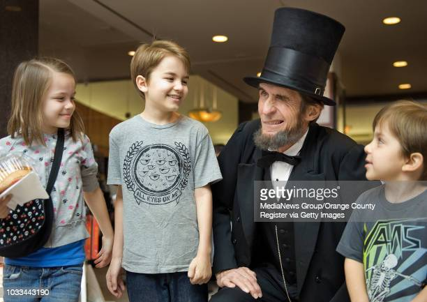 Abraham Lincoln greets siblings Norah Carey from left Nick and Nolan during a Presidents Day celebration at the Richard Nixon Presidential Library on...