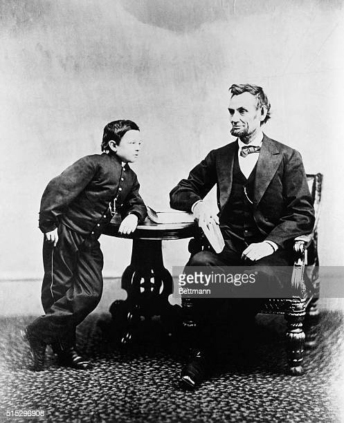 Abraham Lincoln seated with his favorite son Thomas Tad Lincoln