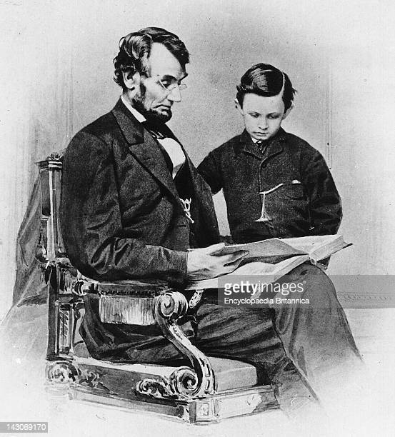 Abraham Lincoln With His Son Tad Abraham Lincoln US President Looking At A Photo Album With His Son Thomas Tad Lincoln February 9 Mathew Brady...