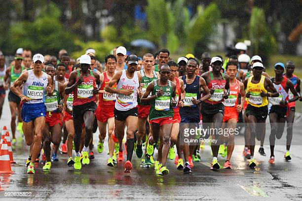 Abraham Niyonkuru of Burundi leads the pack during the Men's Marathon on Day 16 of the Rio 2016 Olympic Games at Sambodromo on August 21 2016 in Rio...