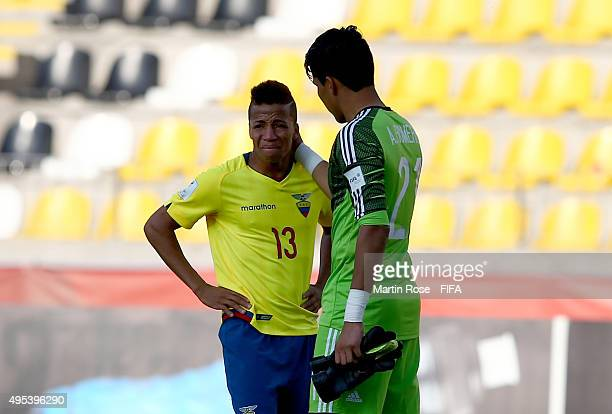 Abraham Romero goalkeeper of Mexico comforts Byron Castillo after the FIFA U17 Men's World Cup 2015 quarter final match between Ecuador and Mexico at...