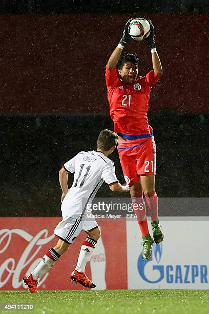 Abraham Romero of Mexico makes a save over Mats Kohlert of Germany during the FIFA U17 World Cup Chile 2015 Group C match between Germany and Mexico...