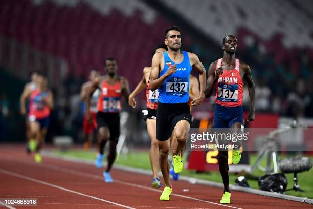 Abraham Rotich of Bahrain and Amir Moradi of Iran compete during the Men's 800m Round 1 Heat 2 on day nine of the Asian Games on August 27, 2018 in...
