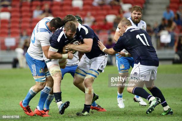 Abraham Steyn of Italy tackles John Barclay of Scotland during the International Test match between Italy and Scotland at Singapore Sports Stadium on...