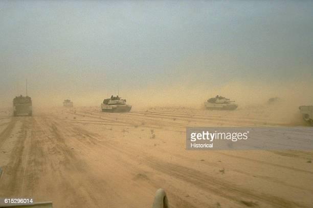 Abrams main battle tanks move across the desert in northern Kuwait during Operation Desert Storm February 28 1991