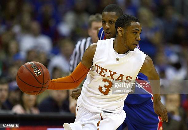 J Abrams of the Texas Longhorns dribbles the ball against the Kansas Jayhawks during the Big 12 Men's Basketball Tournament Finals on March 16 2008...