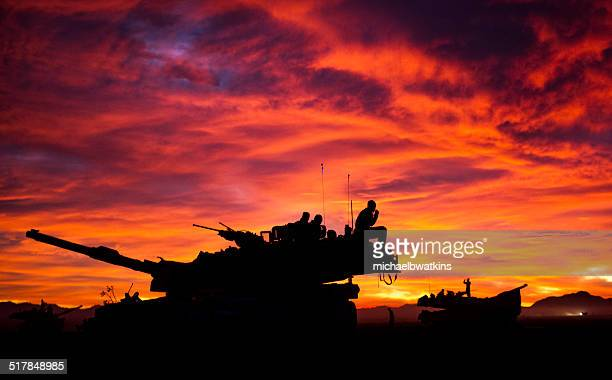 mia1 abrams tank at sunset - armored tank stock photos and pictures