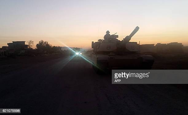Abrams tank of the Iraqi counterterrorism forces leaves the village of Gogjali for the front line on the eastern entrance of Mosul early on November...