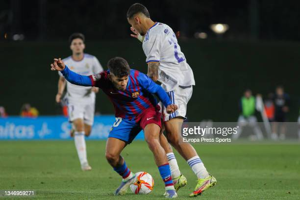 Abre Ezzalzouli of FC Barcelona B and Oscar Aranda of Real Madrid Castilla in action during Primera RFEF Group 2 football match played between Real...