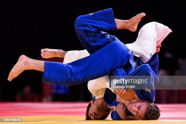 Abrek Naguchev of team Rio de Janeiro of Russia and Javier Pena Insausti of team Athens of Spain compete in the Men's 66kg Mixed Team Semifinal of...