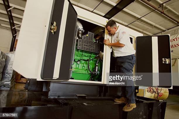 Abriel Hernandez prepares an electrical generator for shipping at Americas Generators May 18 2006 in Miami Florida The generator company which sells...