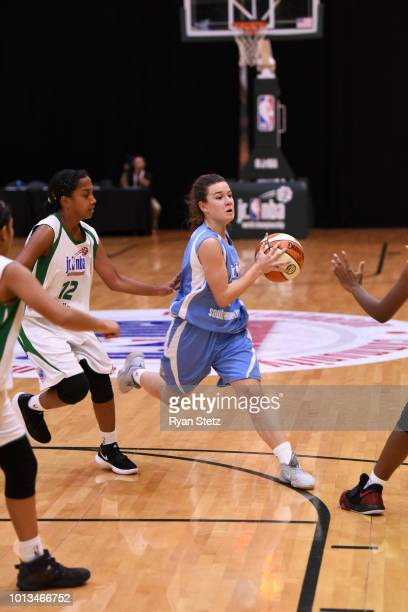 Abril Vernazza of South America Girls handles the ball against India Girls during the Jr NBA World Championships Tournament in Orlando Florida at...