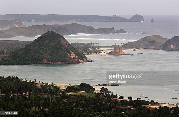abrupt green hills above bays and coastline