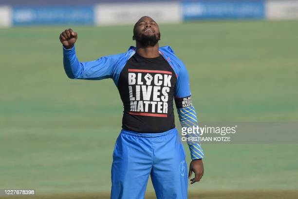 ABs Eagles' Andile Phehlukwayo celebrates after the dismissal of KGs Kingfishers' captain Heinrich Klaasen, while revealing his shirt in solidarity...