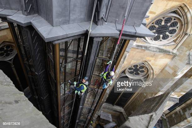 A abseiling team clean the windows on the new tower at Westminster Abbey on March 20 2018 in London England The first new major architectural...