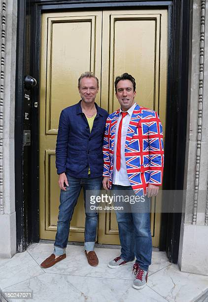 Absolute Radio Breakfast Show host Christian O'Connell poses with Spandau Ballet's Gary Kemp outside the specially painted gold doors at Absolute...