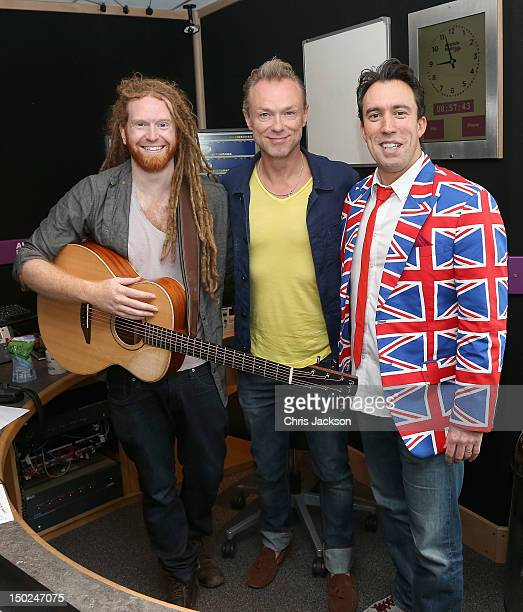 Absolute Radio Breakfast Show host Christian O'Connell poses with singer Newton Faulkner and Gary Kemp at Absolute Radio on August 13 2012 in London...