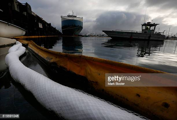 absorbent booms are being used to contain an oil spill leaked from a cargo ship at berth 202 in Los Angeles Harbor March 14 2016 The large...